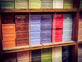 A bunch of the famous Marseille soap, in various scents, in the storefront of a store