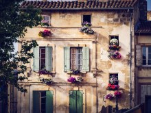 Old house with flowers in the centre of Arles (place du forum)