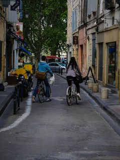 Commuting cycling scene in the center of Arles
