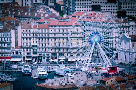 The centre of the old port, with the ferris wheel and the boat docks. View from the Notre Dame de la Garde