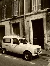 An old Renault in a Pannier city street that looks like coming from the fifties #sepia