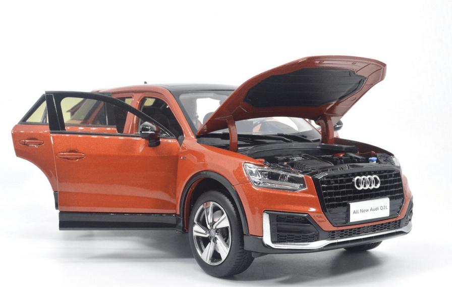 Audi Q2L Paudi orange tous les ouvrants