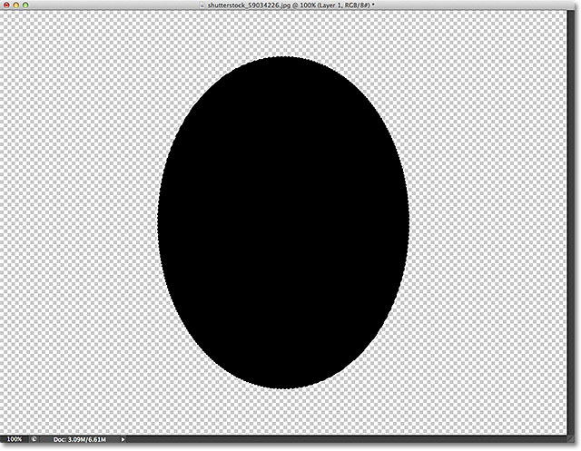 The selection outline has been filled with black. Image © 2012 Photoshop Essentials.com