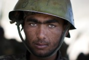 Afghan Army soldier Ahmad, 20, pauses as he cleans his weapon after at a training center on the outskirts of Kabul, on May 8, 2013. (AP Photo/Anja Niedringhaus)