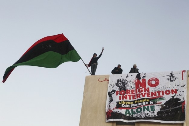 Photo of banner on Libyan building