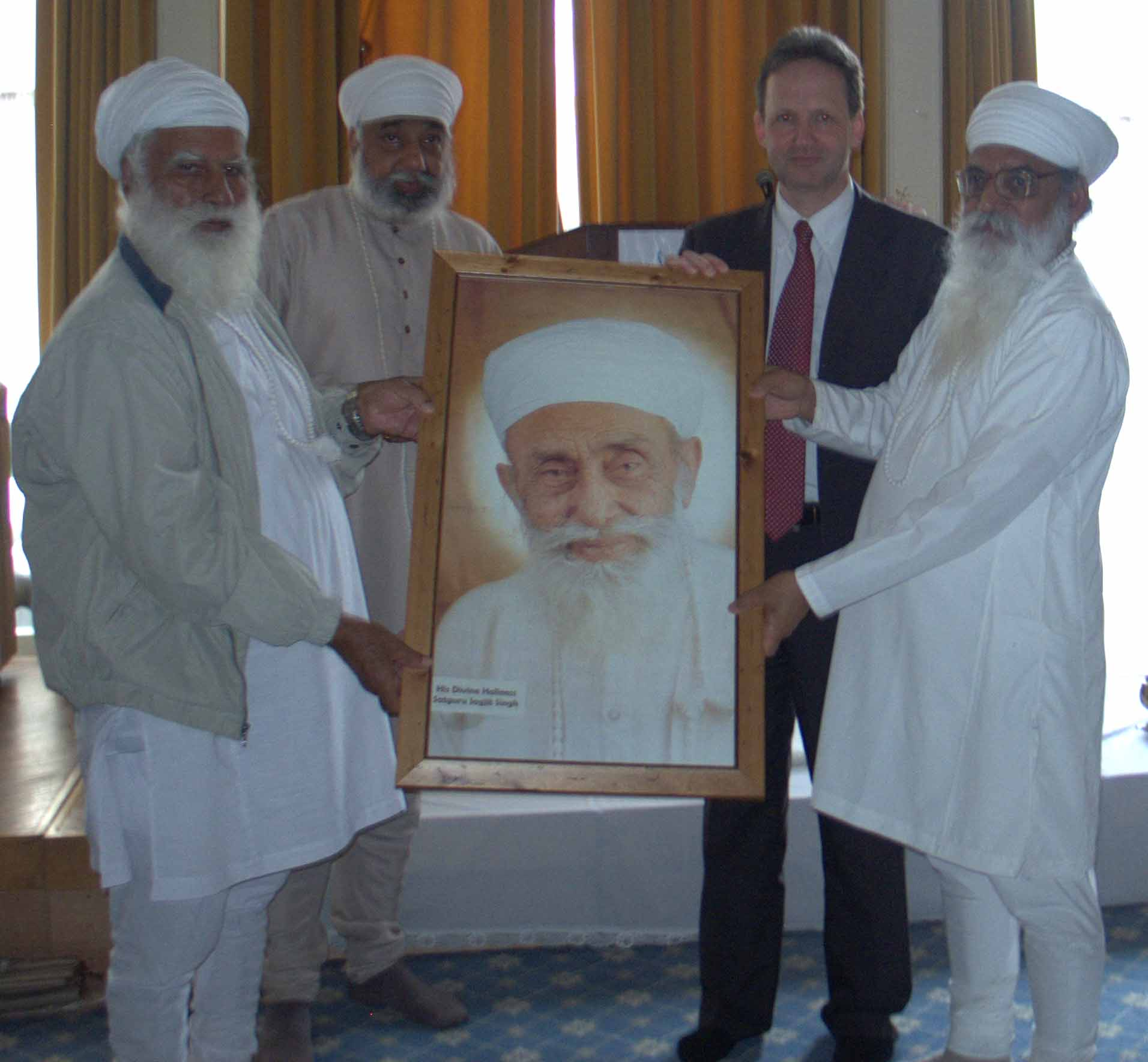 Presented with a Photo of the Sikh Leader His Divine Holiness Satguru Jagjit Singh