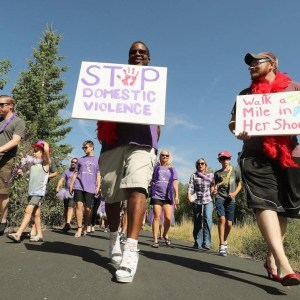 People marching in Park City to end domestic violence for the Peace House