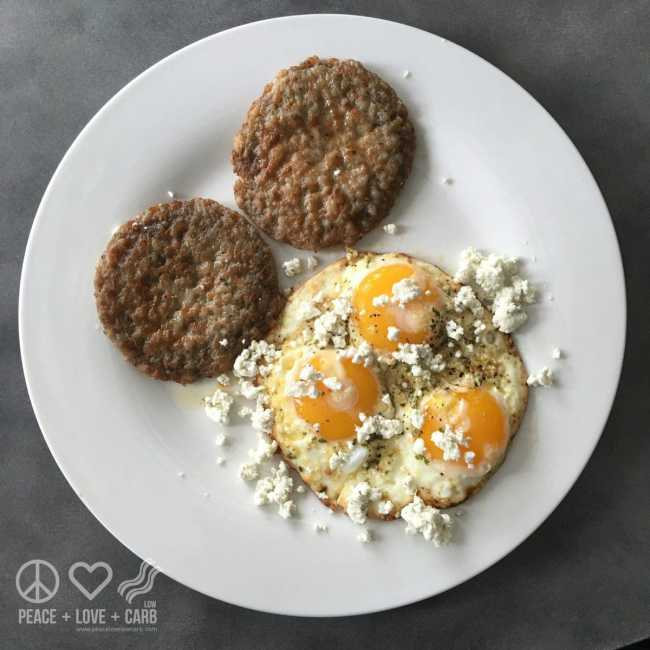 Pastured Eggs topped with Herbed Goat Cheese and Served with Sausage Patties   Peace Love and Low Crab