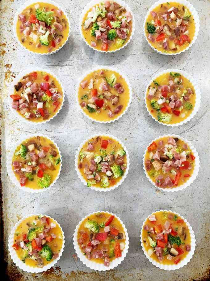 Overhead shot of meat and veggie egg muffins ready to go into the oven