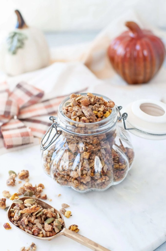 Gluten Free granola in a decorative glass jar, shaped like a pumpikin