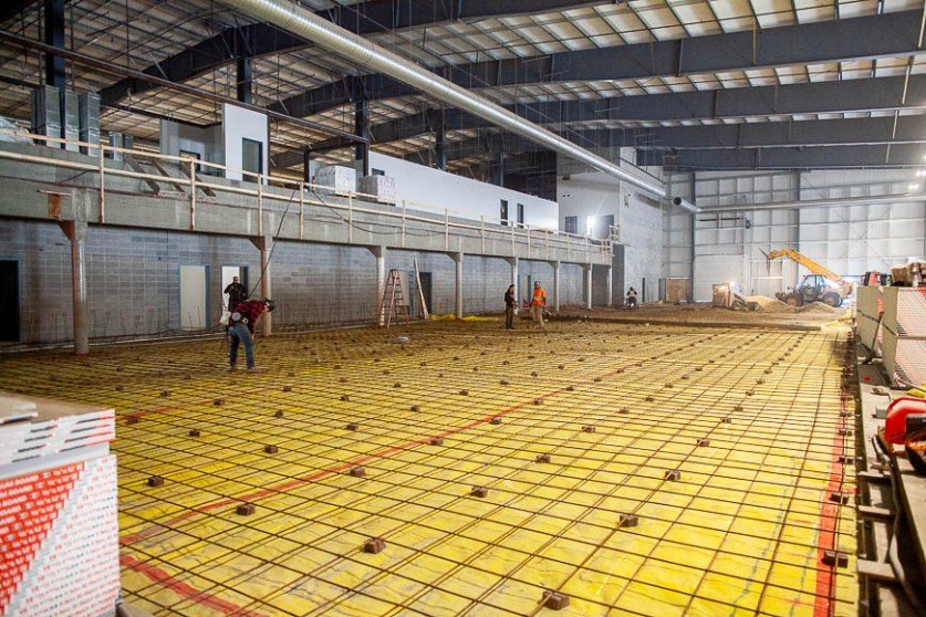 Canadian Natural Fieldhouse and the running track floor under construction.
