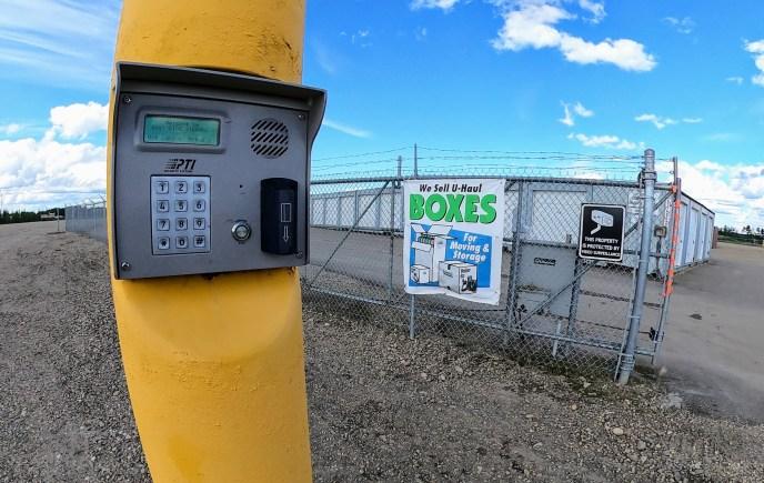 east-side-storage-gate-keypad-entry-fenced-secure-moving-supplies-banner
