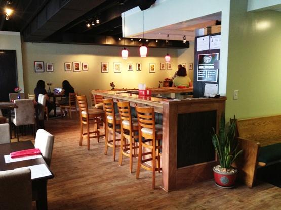 Bar and tables inside of Taste Resturant
