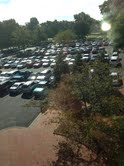 small picture vertical view of WPU parking lot full outside of Flowe building