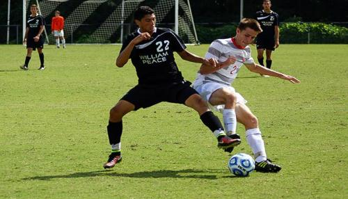 WPU Student trying to keep the ball away from one of the competitors.