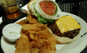 cheeseburger and chips on a plate