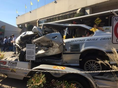 Totalled car on a trailer