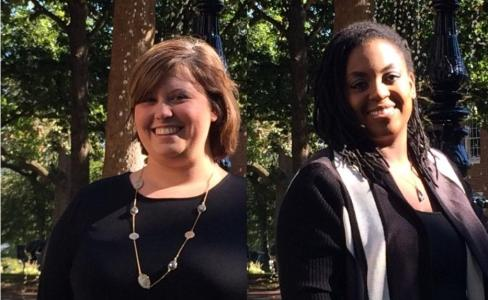 Two William Peace female faculty members stand in front of campus trees outside dressed in black