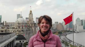 Laura Prewitt in a photo from China with city in background