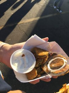 Person holding basket of fried pickles