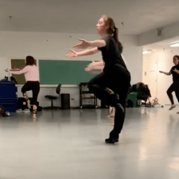 Dance teacher in rehearsal with students