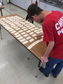 Stamping thank you price tags for art fest.