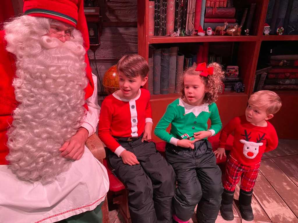 Children looking at Santa Claus with eyes of wonder