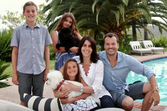 Alina and Bernardo relax poolside with children Dario, Gisella and Tessalina and poodles Caprice and Timber.