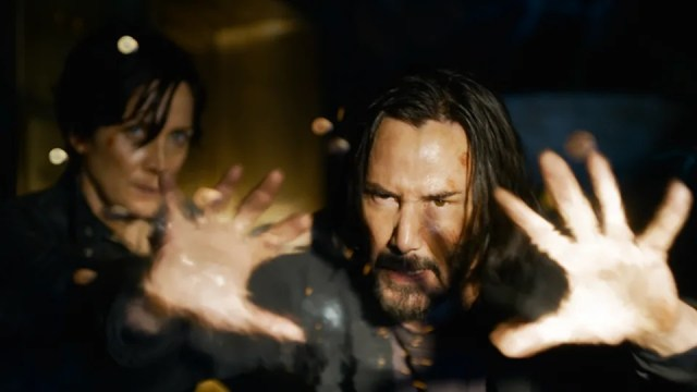 Keanu Reeves reprises his Neo character alongside Carrie-Anne Moss's Trinity (left)