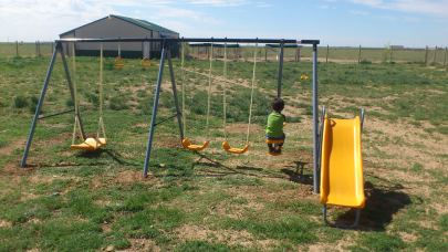 This is a picture of the swing set just after install. The poles on the right side are badly damaged from a run in with the tractor.