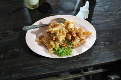 A lovely restaurant on the beach and enjoying my dinner of deep fried whole shrimp