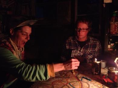 Playing Ticket to Ride in the cabin by oil lamp