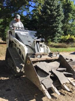 We rented a Bobcat M85 (Mini track loader to break up the asphalt