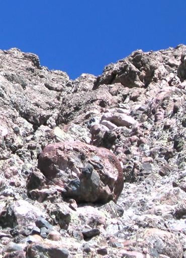 River rocks imbedded in weak cement