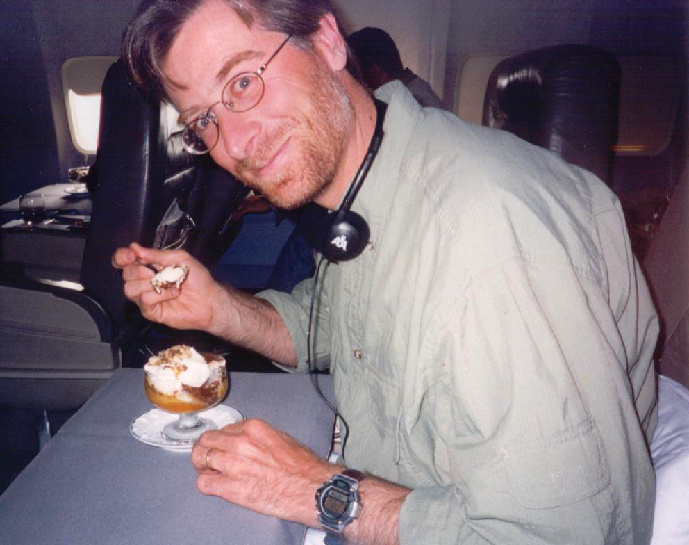 My buddy, Joe, take a break from the beating in cards I gave him all the way home to enjoy some yummy ice cream.