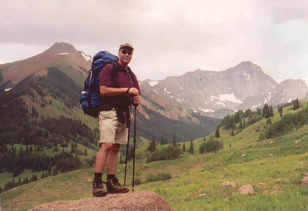 Early in our approach...Mark posing in front of Capitol Peak