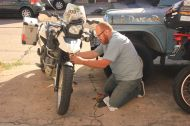 Javier trying to fix Christy's fork seal. It lastet 10km... :))