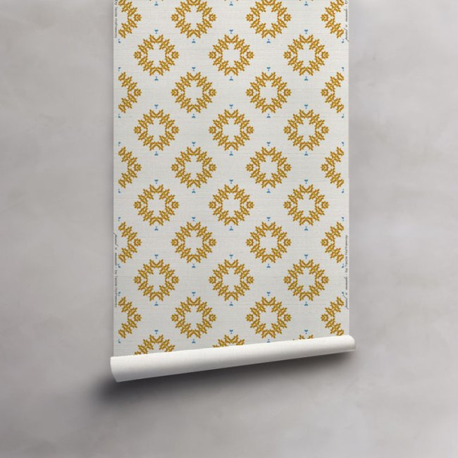 Roll of orange and white wallpaper on luxurious grasscloth wallcovering. Design - Emmett by Pearl and Maude