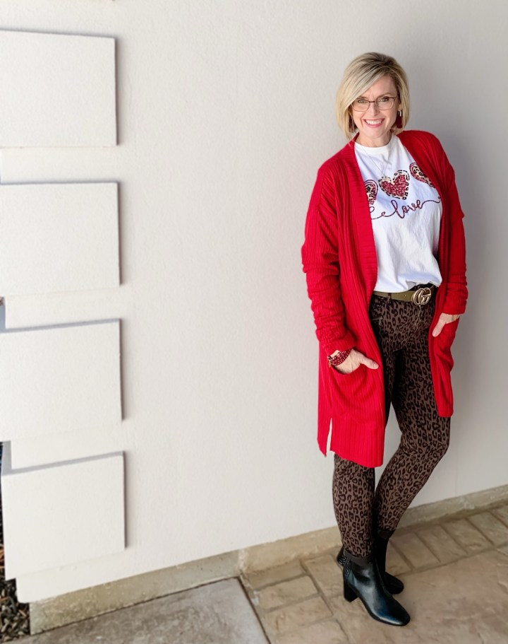 red sweater and graphic tee
