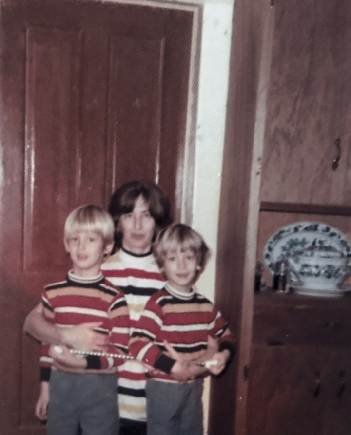 Mother with twin boys in striped shirts