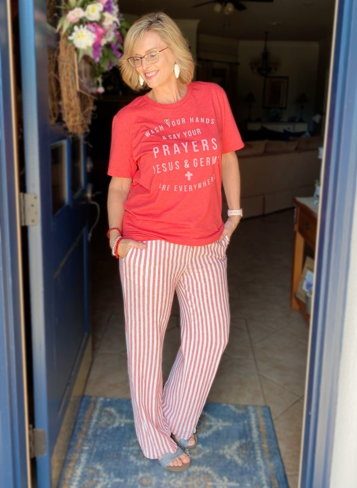 red graphic tee with striped linen wide leg pants