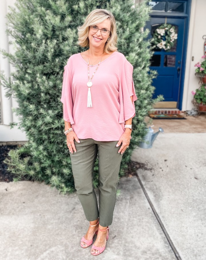 pink blouse with olive green ankle pants for pear shapes