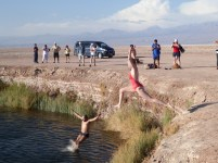 Bridget braving the cold water to jump into a sink hole in the salt field.