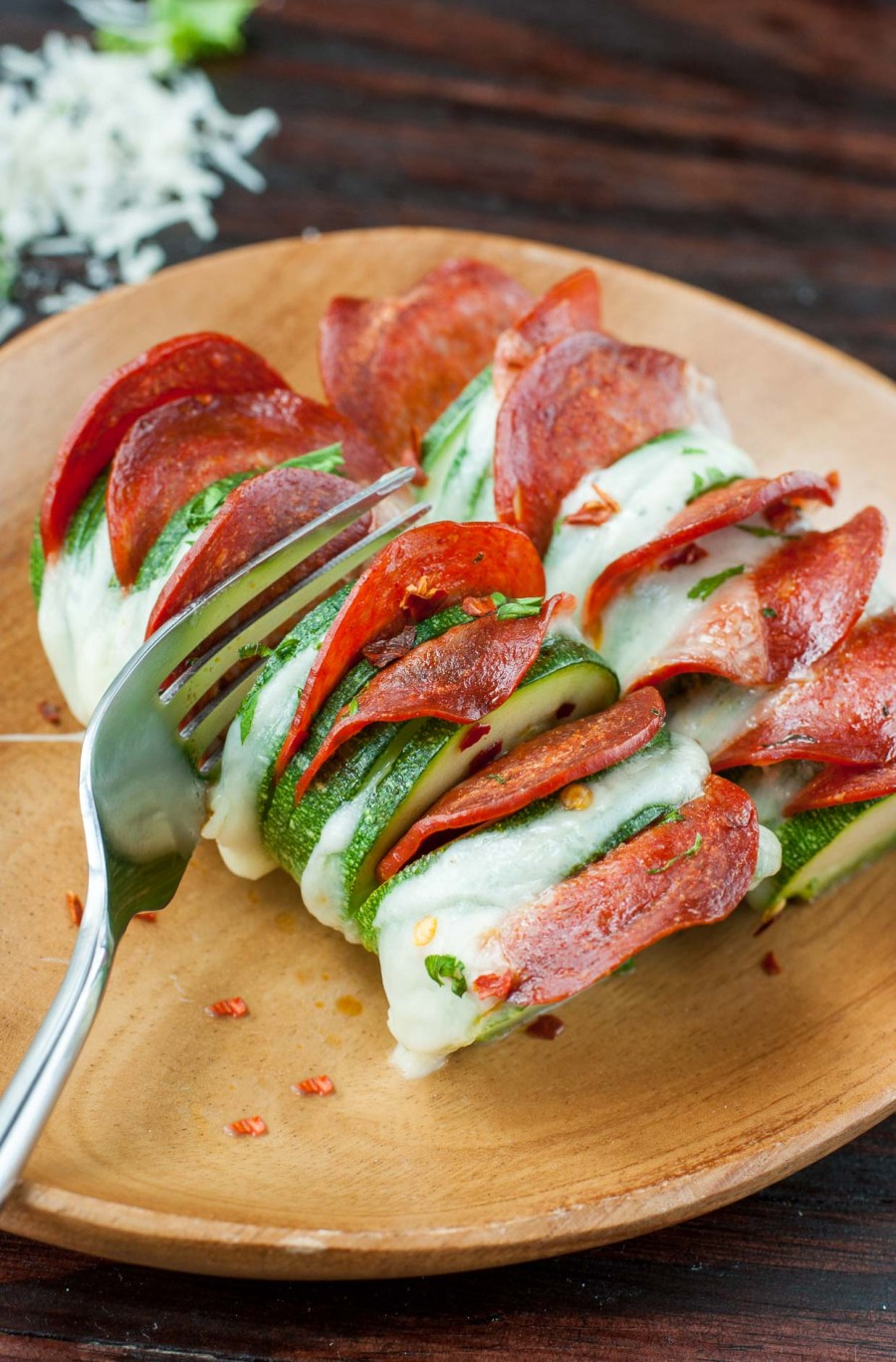 Your pizza dreams have come true with these Cheesy Hasselback Zucchini Pizzas! This tasty foil-baked side is guaranteed to impress and SO easy to make!