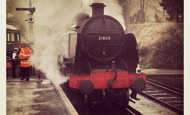 Arriving in clouds of steam. #steam #watercressline #locomotive