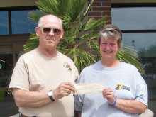 Jim Ellison presents check to Pam Boren.