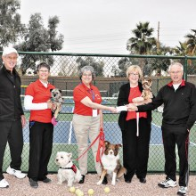 Left to right: Mike Crabtree (2015 President of Pickleball Club), Sarah Marsh (Secretary of Therapy Paws), Jean Reynolds (President and Co-Founder of Therapy Paws), Candy Lawson (Treasurer of Therapy Paws) and Gordon Cooper (2015 Treasurer of Pickleball Club). The dogs are Bess, Finnley, Nelli and Abby.