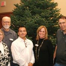 Left to right: Barbara Magnuson, Larry Magnuson, Nicholas Damask, speaker, President Linda Migliore, Treasurer Jonathan Schofield