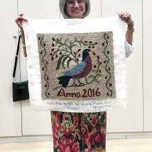 Sheila Millendorf proudly displays her first project.