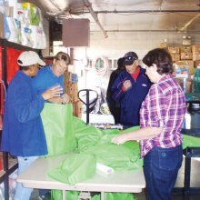 Community Church members and friends fill dinner bags from the Agua Fria Food Bank's inventory.